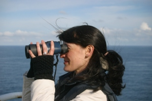 Beth hides behind an unfeasibly large pair of binoculars!