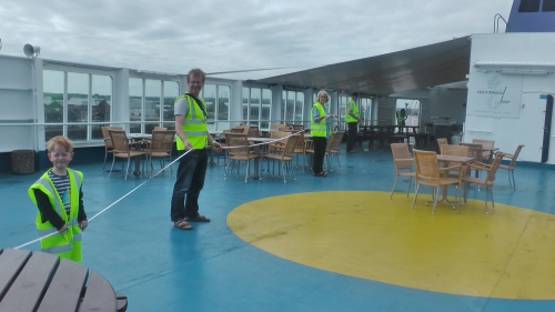 The families measuring out the size of a blue whale on our top deck.