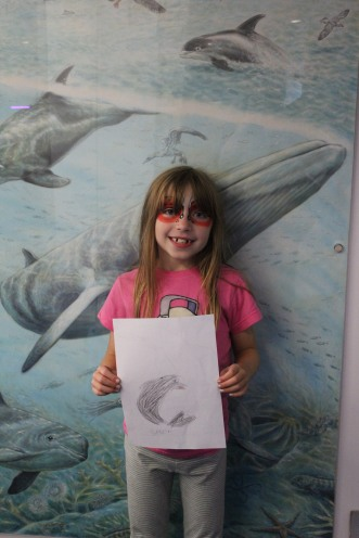 Norah (8) with her brilliant dolphin drawing!